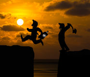 Concept cartoon silhouette, Man hold axe and  Man jumping over p Stock Photos