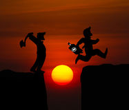 Concept cartoon silhouette, Man hold axe and  Man jumping over p Royalty Free Stock Photography