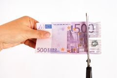 Concept of cash back. The scissors cut banknote 500 euros inscription cash back royalty free stock image