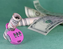Concept of cash deposit - dollars with lock Stock Images