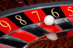 Concept of casino roulette wheel with code of Fortune. Concept of classic casino roulette wheel with code of Fortune lucky numbers 9-8-7-6-5. Black and red Royalty Free Stock Photography