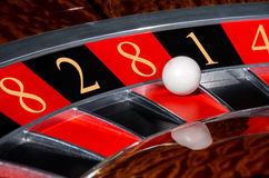 Concept of casino roulette wheel with code of Fortune. Concept of classic casino roulette wheel with code of Fortune lucky numbers 8-2-8-1-4. Black and red Royalty Free Stock Image
