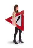 Concept of caution - Woman standing with caution sign stock photo