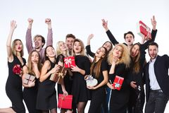 Group of young beautiful people in stylish clothes with gift boxes in hands having fun. Royalty Free Stock Photos