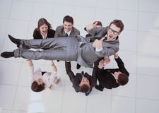 Concept of celebrating success.happy business team smiling, shak Royalty Free Stock Photos