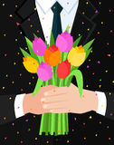 Concept of celebration. Bouquet of beautiful flowers. Business man holding out a bunch of tulips. Flat design, vector illustration Stock Photos