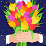 Concept of celebration. Bouquet of beautiful flowers. Business man holding out a bunch of tulips. Flat design, vector illustration Stock Images