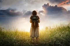 Concept of challenge. Concept of challenge, success, victory, struggle. Journey woman standing in nature with sunlight Stock Photo