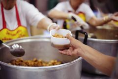 Concept charity for homeless with volunteers donating feeding free food.  royalty free stock photo