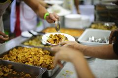 Concept charity for homeless with volunteers donating feeding free food.  stock images