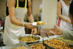 Concept charity for homeless with volunteers donating feeding free food.  royalty free stock photography