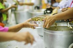 Concept charity for homeless with volunteers donating feeding free food.  stock photography