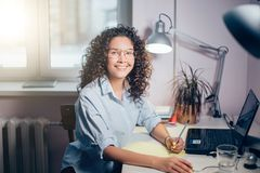 Concept of cheerful woman. smiling female writing with left hand. Left-hader. happy girl stock photos