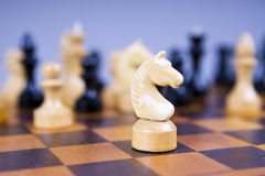 Concept with chess pieces on a wooden chess board Stock Image