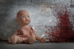 Concept of child abuse - Bloody doll Royalty Free Stock Photos