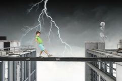 Do not let your child walking around. Mixed media. Concept of child in danger walking on balk. Mixed media Royalty Free Stock Photos