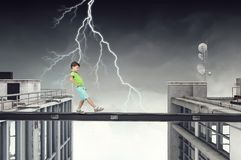 Do not let your child walking around. Mixed media. Concept of child in danger walking on balk. Mixed media Royalty Free Stock Image
