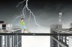 Do not let your child walking around. Mixed media. Concept of child in danger walking on balk. Mixed media Stock Images