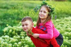 The concept of children`s friendship , boy and girl on a walk stock photos
