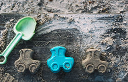 Concept of children toys on a child sandbox Royalty Free Stock Image