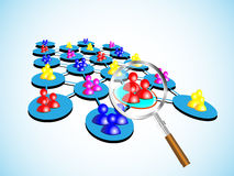 Concept of choosing a success team with magnifier Stock Images