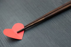 Concept, Chopsticks take a heart like some food. Stock Photography