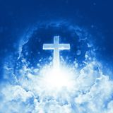 Concept of christian religion shining cross on background of cloudy sky. Divine shining heaven. Sky cross and beautiful clouds royalty free stock photography