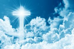 Concept of christian religion shining cross on the background of cloudy sky. Sky with cross and beautiful cloud. Divine shining. Heaven, light. Peaceful royalty free stock photography