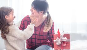 Christmas concept, the Daughter gives a gift to her mother stock images