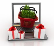 Concept of Christmas online shopping. 3d illustration. Laptop computer with festive shopping baskets on white background Royalty Free Stock Photo