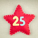 Concept for christmas, red star with wooden numbers 25 Stock Photo