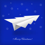 Concept of the Christmas tree and origami airplane Stock Image