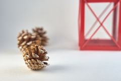 Concept for Christmass and New year of cones and part of red lantern on a blurred background. stock photography