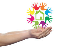 Concept circle of hands, green house symbol Stock Image