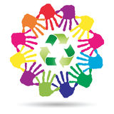 Concept circle of hands, green recycle symbol. Conceptual circle or spiral made of painted human hands with green recycle symbol Stock Images