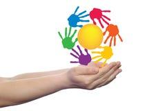Concept circle of hands, yellow sun symbol Stock Photos