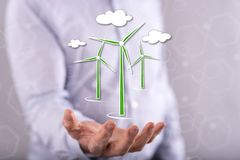 Concept of clean energy. Clean energy concept above the hand of a man in background Stock Photo
