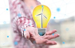 Concept of clean energy. Clean energy concept above the hand of a woman in background Stock Image