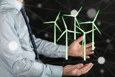 Concept of clean energy. Clean energy concept above the hands of a man Stock Photos