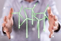 Concept of clean energy. Clean energy concept between hands of a man in background Royalty Free Stock Image