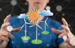 Concept of clean energy. Clean energy concept between hands of a man in background Stock Photos