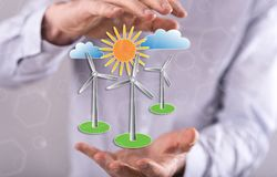 Concept of clean energy. Clean energy concept between hands of a man in background Stock Photography