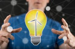 Concept of clean energy. Clean energy concept between hands of a man in background Stock Images