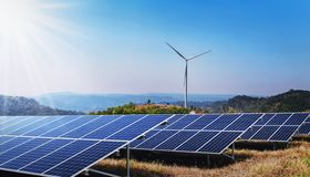concept clean energy power in nature. solar panel and wind turbine on hill royalty free stock photo