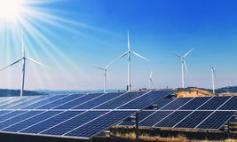 Concept clean energy power in nature. solar panels and wind turbine. On hill stock photo