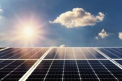 Concept clean power energy. solar panel and sunlight with blue s. Ky background royalty free stock photography