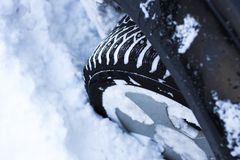 Concept - close-up of a car wheel in the snow Royalty Free Stock Photos