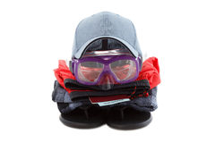 Concept of clothing and diver goggles, preparing for rest, isolated on white. Background royalty free stock images