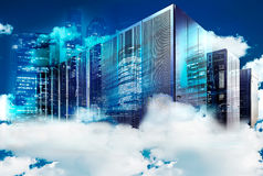 Concept of cloud computing. Cluster of supercomputers in the clouds on the background of a modern metropolis Stock Photo
