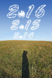 Concept for 2016 with cloud in the sky. With shadow on the grass stock photos